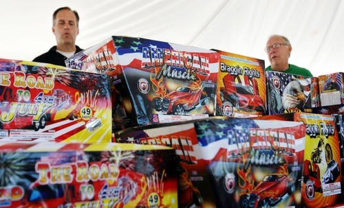 Steve Griffin  |  The Salt Lake Tribune  Examples of the newly legalized fireworks are stacked up as Theron Watson, left, and his father, Ted Watson, get one of their Olympus Fireworks tents ready Mondayin Ogden. The Watson family runs the largest distributor of fireworks in Utah.