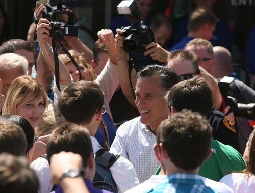LEAH HOGSTEN  |  The Salt Lake Tribune Mitt Romney is surrounded by supporters on Friday during his one public appearance of the trip -- at the Hires Big H Drive-in in Salt Lake City. Advisers to the former Olympics chief are pushing to move up Utah's primary on 2012 calendar.