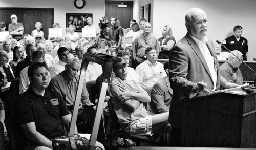 Leah Hogsten  |  The Salt Lake Tribune Bruce Baird outlines what the Tavaci development would entail to the council members and attendees.   Activists and residents of Cottonwood Heights packed the Cottonwood Heights city council meeting to protest the proposed plan to build Tavaci, a mixed-use resort at the mouth of Big Cottonwood Canyon on land owned by Terry Diehl  Tuesday, June 28 2011  Cottonwood Heights.  The Council is discussing a new zoning ordinance, called Canyons Resort Residential, that the planning commission approved in Aug. 2009 with very little scrutiny. The Council will vote on the proposed development later this summer.