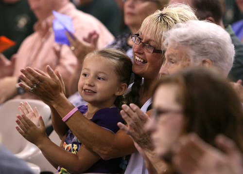 Leah Hogsten  |  The Salt Lake Tribune Con-Quest graduate Brett Patterson's wife, Mandy, and daughter Konstence, 5, applaud him as he walks to receive his diploma. Graduates of the Utah State Prison's Con-Quest substance-abuse program received a diploma Thursday in Draper. The Con-Quest program is a residential substance abuse treatment program that lasts 12 to 18 months.