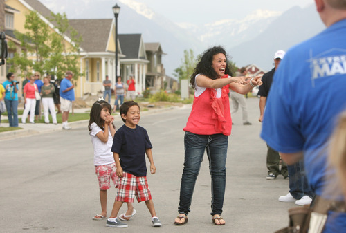Leah Hogsten  |  The Salt Lake Tribune Jessica Gomez and her two children, Ellie, 5, and Jonah, 7, are welcomed at their new home in Daybreak by