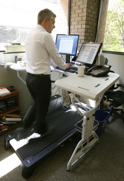 Francisco Kjolseth  |  The Salt Lake Tribune Even people who exercise regularly are at risk of chronic disease if they sit too much at work, home, in the car or in front of the TV. Michael Mozdy, manager of Internal Communications and Public Affairs at the University of Utah, uses a treadmill desk known as a Trek Desk that spans a treadmill as he tries to actively recover from back surgery six months ago.