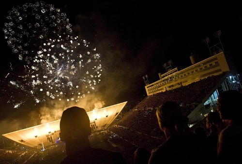 Djamila Grossman     The Salt Lake Tribune People watch fireworks during the Stadium of Fire event in honor of the Fourth of July at Lavell Edwards Stadium in Provo, Utah, on Saturday.