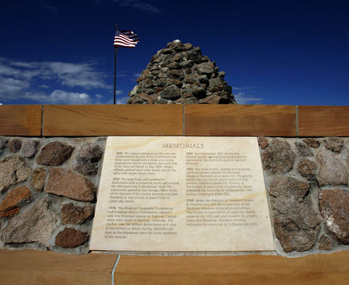 Tribune file photo The American Flag flies over the Mountain Meadows Massacre Memorial near Enterprise in 2007. It has been named a national landmark.