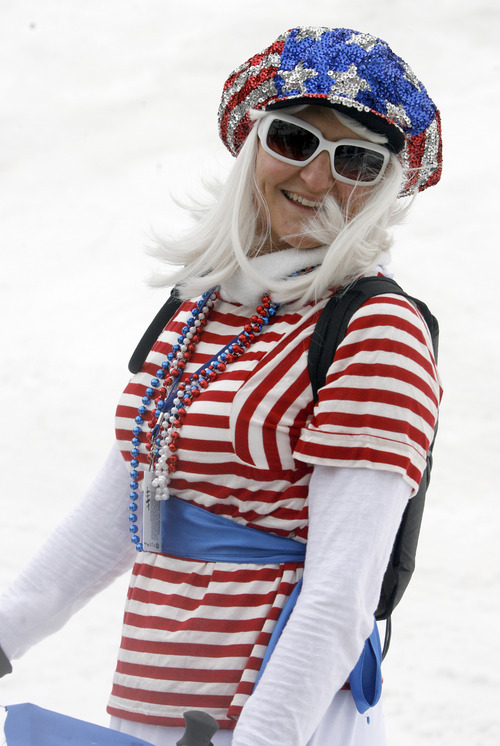 Rick Egan   |  The Salt Lake Tribune  Lori Clark, Park City, wears the stars and stripes as she waits in the lift line, at Snowbird, Monday, July, 4, 2011