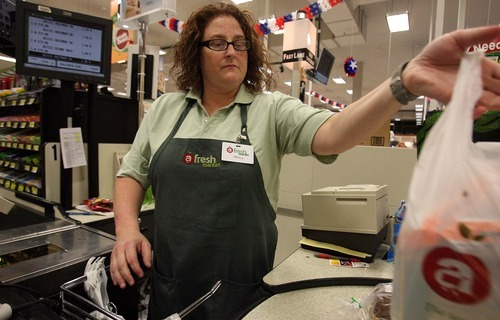 Leah Hogsten  |  The Salt Lake Tribune Fresh Market employee Angela Neeley at work Thursday, June 23 2011, in Sandy. Five Fresh Market stores have closed during challenging times for the chain's parent company, Associated Food Stores.