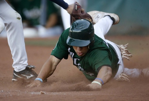 Trent Nelson  |  The Salt Lake Tribune Utah center fielder Domonique Taylor slides safely into home. Utah Bucks vs. Washington Hornets, baseball at Gates Field, Kearns High School in Kearns, Utah on Friday, July 1, 2011