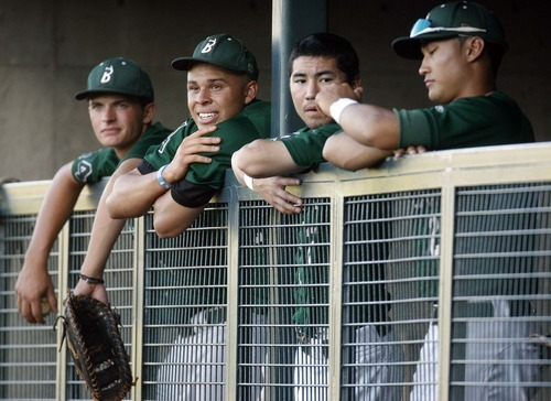 Trent Nelson  |  The Salt Lake Tribune Utah's Cameron Gust, Dominique Taylor, Carter Yagi and Eric Takenaka watch from the dugout as the Utah Bucks play the Washington Hornets at Gates Field in Kearns on July 1.