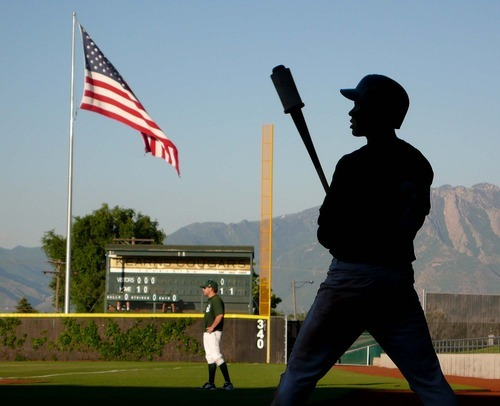 Trent Nelson  |  The Salt Lake Tribune Utah center fielder Domonique Taylor warms up, Utah Bucks vs. Washington Hornets, baseball at Gates Field, Kearns High School in Kearns, Utah on Friday, July 1, 2011