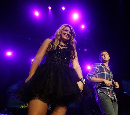 Steve Griffin  |  The Salt Lake Tribune  American Idol finalists Lauren Alaina and Scotty McCreery perform a duet at the Maverik Center during the debut of the American Idol nationwide tour in West Valley City, Utah Wednesday, July 6, 2011.