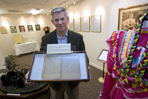 Al Hartmann  |  The Salt Lake Tribune Fernando Gozez is executive director of Museum of the History of Mormonism in Mexico, which has opened branch at 1501 N. Canyon Road, in Provo, highlighting LDS history south of the border.   He holds  original hand-written agenda minutes from church meetings in Monterey, Mexico ,from 1922.