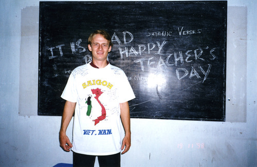 Photo courtesy of Eli Cawley Eli Cawley, in this photograh taken Nov. 20, 1998, stands in front of a blackboard during Teachers' Day at the school in Vietnam where he taught English. While teaching, Cawley met the woman who would become his wife, Nguyet