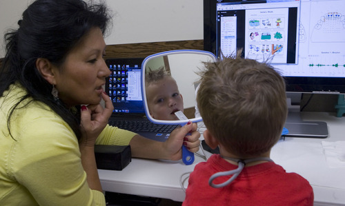 Al Hartmann  |  The Salt Lake Tribune Five-year-old Breyton Banks uses a device called a palatometer in a speech therapy session with speech language pathologist Ann Dorais at the Comprehensive Clinic on BYU campus.   The custom-fit retainer allows therapists to use computers to watch precisely how kids pronounce words and help them correct their speech in real time.