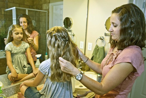Paul Fraughton  |  The Salt Lake Tribune Mindy McKnight creates a waterfall braid on her daughter's hair. The braid is one of the most popular styles featured on her YouTube channel.