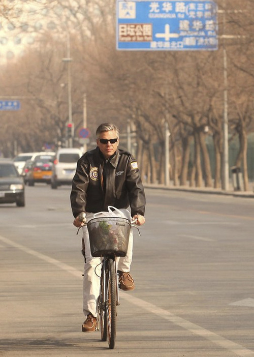 Jon Huntsman Jr. served as U.S. ambassador to China from fall of 2009 through April of this year. Here he is pictured cycling in Beijing. Courtesy Image
