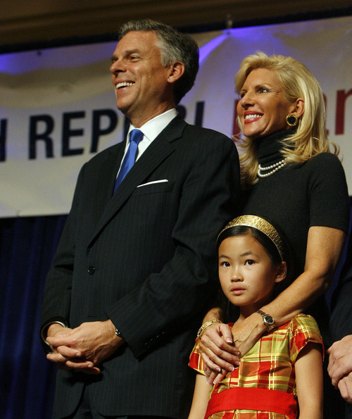 Utah Gov. Jon Huntsman, left,  and First Lady Mary Kaye Huntsman and daughter Gracie Mei Huntsman laugh as they listen to then-Lt. Gov. Gary Herbert as he addresses supporters during election night celebrations in this 2008 Tribune file photo.