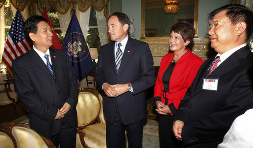 The Associated Press Governor and Misses Herbert, center, talk with Luo Huining, governor of Qinghai Province, left, and Wang Sanyun, governor of Anhui Province, right, during a meet-and-greet prior to a luncheon hosted by Governor Herbert for Chinese governors delegation on Thursday at the Governor's Mansion.