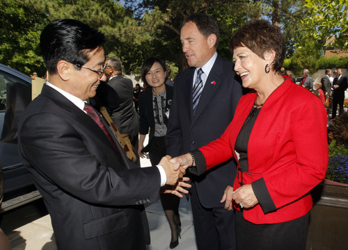 Pool photo  |  The Associated Press Utah Gov. Gary Herbert and wife Jeanette, right, greet Zhao Hong Zhu, party secretary of Zhejiang Province, prior to a luncheon hosted for the Chinese governors' delegation Thursday.
