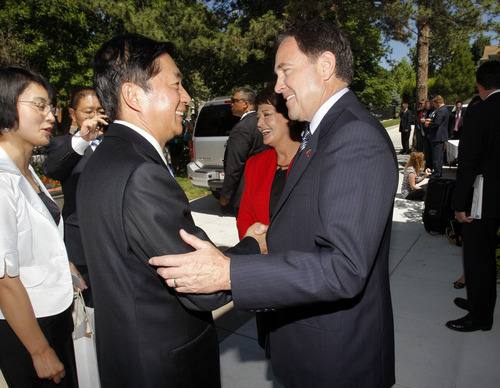 Pool photo  |  The Associated Press Utah Gov. Gary Herbert, right, shakes hands with Luo Huining, governor of Qinghai Province, prior to a luncheon hosted for the Chinese governors' delegation Thursday.
