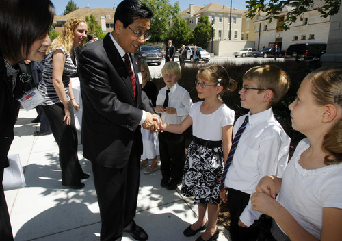 Pool photo  |  The Associated Press Zhao Hong Zhu, party secretary of Zhejiang Province, greets a group of singers from East Lake Elementary prior to a luncheon hosted by Gov. Gary Herbert for the Chinese governors' delegation Thursday.