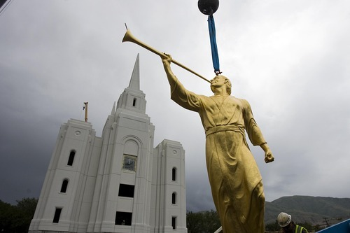 Djamila Grossman  |  The Salt Lake Tribune  A statue of the angel Moroni is being prepared to be hoisted atop the new Brigham City Temple of The Church of Jesus Christ of Latter-day Saints on Tuesday, July 12, 2011.