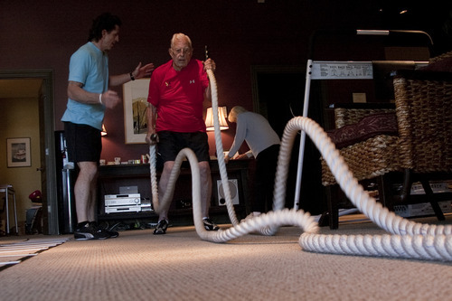 Margaret Distler  |  The Salt Lake Tribune  Paul Holbrook, owner of Age Performance personal training studio, assists Ted Belknap with a rope undulation exercise during Belnap's workout session on Tuesday, June 21, 2011.