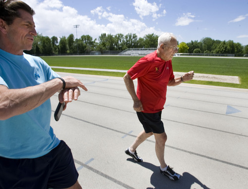 Al Hartmann  |  The Salt Lake Tribune Ted Belknap, 90, is training to run the 50-meter-dash at the Huntsman Games this summer.   He nears the finish line and is timed by his trainer Paul Holbrook.