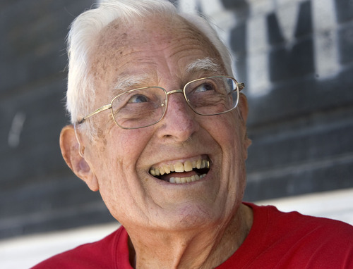 Al Hartmann  |  The Salt Lake Tribune Ted Belknap, 90, is training to run the 50-meter-dash at the Huntsman Games this summer.   He laughs with his trainer after a practice run in 95-degree heat.