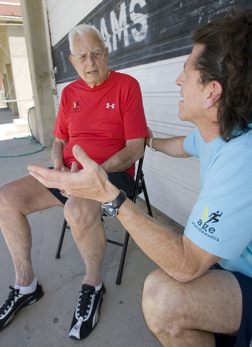 Al Hartmann  |  The Salt Lake Tribune Ted Belknap, 90, is training to run the 50-meter-dash at the Huntsman Games this summer.   He catches his breath and talks with his trainer Paul Holbrook, right, how the run went.  He ran it in 22 seconds (not bad for his second effort).  Holbrook thinks that anaerobic interval training is far superior to long duration aerobics, especially for older adults who need to strengthen their fast-twitch muscles to prevent falls and maintain peak fitness.