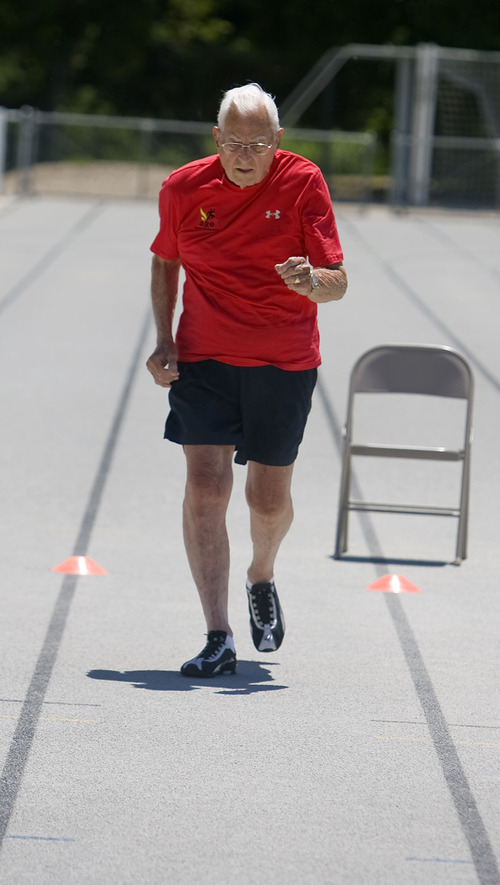 Al Hartmann  |  The Salt Lake Tribune Ted Belknap, 90, is training to run the 50-meter-dash at the Huntsman Games this summer.   He takes off in 95-degree heat on the Highland High School track for his one practice sprint.