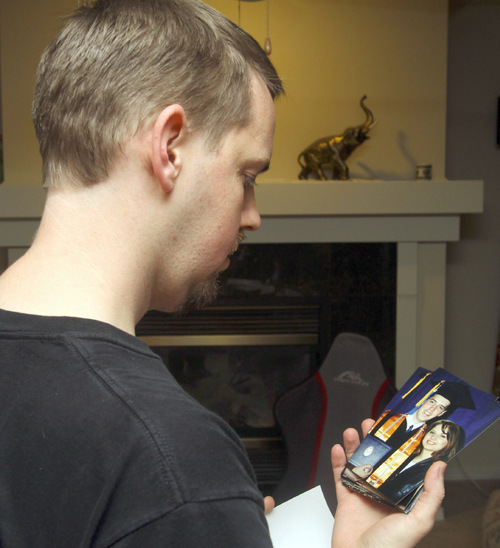 Rick Egan   The Salt Lake Tribune Josh Powell, looking at a family photo from his 2002 college graduation, said his wife, Susan, is