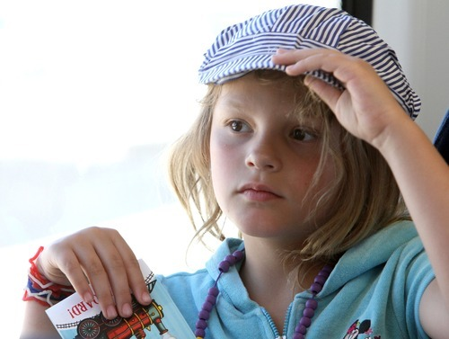 Rick Egan      The Salt Lake Tribune Jenna Johnson Hall, 7, wears a train conductor hat as she rides the new Mid-Jordan TRAX line to Daybreak from Gardner Village on Friday. The test ride was offered to