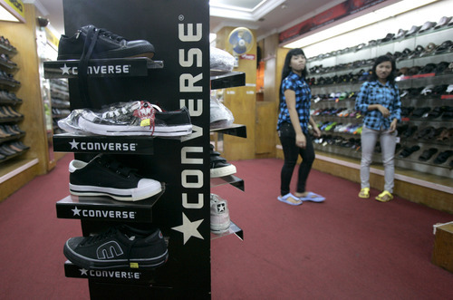Irwin Fedriansyah  |  The Associated Press Converse shoes are displayed at a store in Jakarta, Indonesia. Workers making Converse sneakers in Indonesia said supervisors throw shoes at them, slap them in the face and call them dogs and pigs. Nike, the brand's owner, admits that such abuses have occurred among the contractors that make its hip high-tops but claims there was little it could do to stop it.
