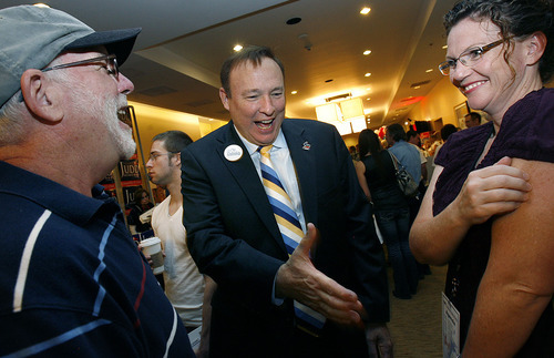 Scott Sommerdorf  |  The Salt Lake Tribune Jim Dabakis, candidate for Utah Democratic party chairman, center, speaks with the Syracuse Mayor Jamie Nagle, right, and Bing Kerwood at the Democratic convention at the Hilton Hotel in downtown Salt Lake City on Saturday.
