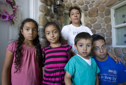 Al Hartmann  |  The Salt Lake Tribune Maribel Melgar poses with her children, twins Cindy and Diane, 7, left, Andy, 4, and Hans, 16, at their Orem home.      Husband and father Rogelio Melgar was arrested by immigration for allegedly using a fake ID to work in the country illegally.
