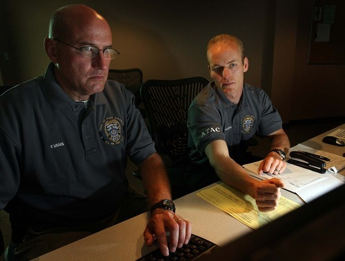 Leah Hogsten  |  The Salt Lake Tribune Ogden Crime Center police officers Nick Poorte  (right) and Bob Evans are among four employees who staff the