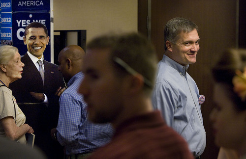 Scott Sommerdorf  |  The Salt Lake Tribune Congressman Jim Matheson does a television interview in the hallway at the Democratic convention at the Hilton Hotel on Saturday as a cardboard cutout of President Barack Obama smiles in the background.