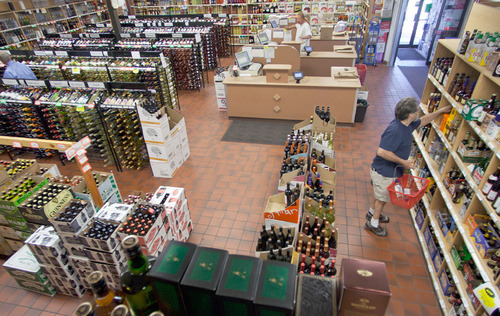 Michael Mangum  |  The Salt Lake Tribune  Doug Sloan, right, organizes inventory at the Utah State Liquor Store,  at 1457 S. Main St., which closed in April.
