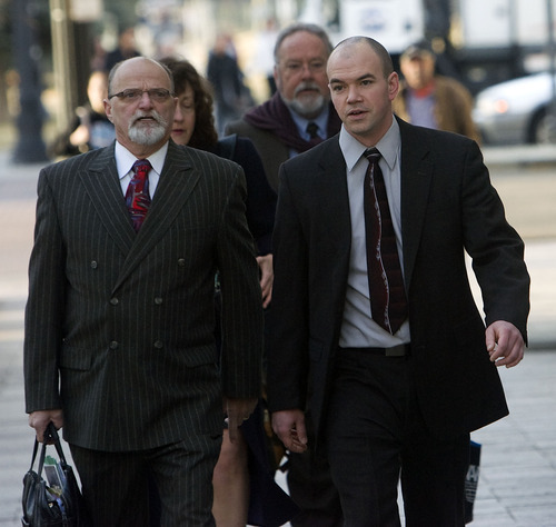 Al Hartmann   |  The Salt Lake Tribune  Tim DeChristopher, right,  enters Frank Moss Federal Courthouse in Salt Lake City on Thursday, March 3 with his lawyer Ron Yengich.