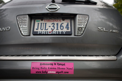 John Wyatt of Dumfries, Va., is trying to get custody of his daughter, Emma, who was given up for adoption to a Utah couple by the girl's mother without his consent. A bumper sticker is shown on one of the family cars.  (Photo by Dayna Smith)