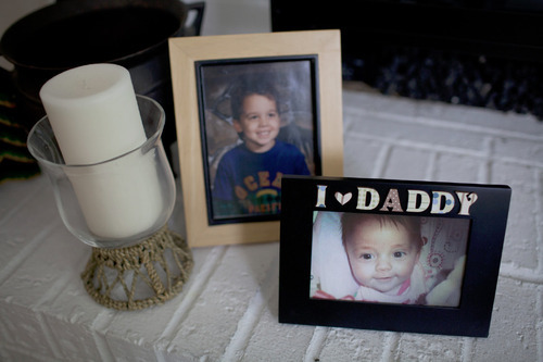 John Wyatt of Dumfries, Va., is trying to get custody of his daughter, Emma, who was given up for adoption to a Utah couple by the girl's mother without his consent. Pictures on the fireplace of John as a child, and Emma. (Photo by Dayna Smith)