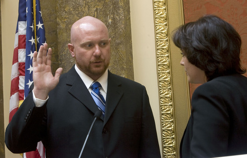 Al Hartmann  |  The Salt Lake Tribune Brian Doughty, newly elected to the Utah House of Representatives, is sworn in by Speaker of the House Becky Lockhart during a legislative special session Wednesday. He replaces Rep. Jackie Biskupski, who resigned.
