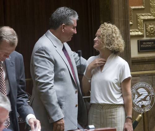 Al Hartmann  |  The Salt Lake Tribune Jackie Biskupski, Utah's first openly gay legislator, right, says goodbye to friend and former Speaker of the House David Clark during the special legislative session Wednesday.