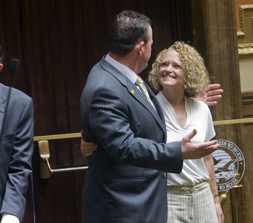 Al Hartmann  |  The Salt Lake Tribune Jackie Biskupski, Utah's first openly gay legislator, gets a hug goodbye from Rep. Carl Wimmer during the special legislative session Wednesday.