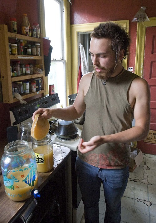 Paul Fraughton  |  The Salt Lake Tribune Matt DelPorto pulls the kombucha culture from a jar. He will use a piece of the culture in a brewed tea that will then be covered with a cloth and left to ferment.
