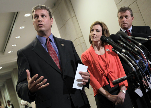 Republican House members talk about their meeting at the Capitol with economists from Standard & Poors on the the potential negative impact to America's credit rating if Congress does not reach a deficit reduction agreement, in Washington, Thursday, July 21, 2011. From left to right are Rep. Bill Huizenga, R-Mich., Rep. Nan Hayworth, R-N.Y., and Rep. Charles Dent, R-Pa.  (AP Photo/J. Scott Applewhite)