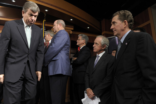 Sen. Roy Blunt, R-Mo., left, walks off of the stage after speaking at a news conference on the debt ceiling on Capitol Hill in Washington, Thursday, July 21, 2011. Blunt was joined by, from right, Sen. Jim DeMint, R-S.C., Sen Bob Corker, R-Tenn., Sen.  Tom Coburn, R-Okla., and Rep. Reid Ribble, R-Wisc.  (AP Photo/Susan Walsh)