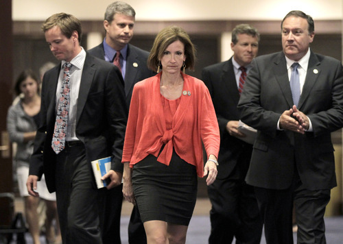Rep. Nan Hayworth, R-N.Y., center, a member of House Financial Services Committee, walks with other Republican House members following  a closed-door meeting at the Capitol with economists from Standard & Poors on the the potential negative impact to America's credit rating if Congress does not reach a deficit reduction agreement, in Washington, Thursday, July 21, 2011.  (AP Photo/J. Scott Applewhite)