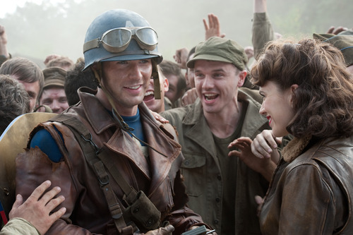Hayley Atwell portrays Peggy Carter and Chris Evans portrays Steve Rogers in a scene from the film