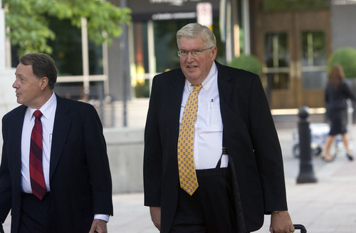 Al Hartmann  |  The Salt Lake Tribune  Dewey MacKay, right, a Brigham City doctor charged with illegally prescribing millions of pain pills, walks with his lawyer to Frank Moss Federal Courthouse on Wednesday for the opening of trial.